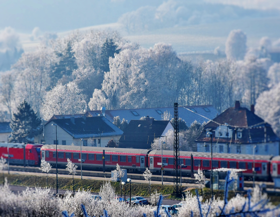 Large canva   train station in snowy landscape